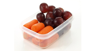carrots and grapes in a snack pot
