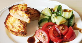 Individual cheese and bacon quiche with salad
