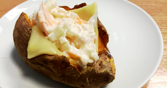 Baked sweet potato with melting cheese and coleslaw