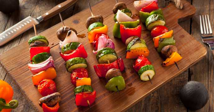 vegetable kebabs on a wooden board