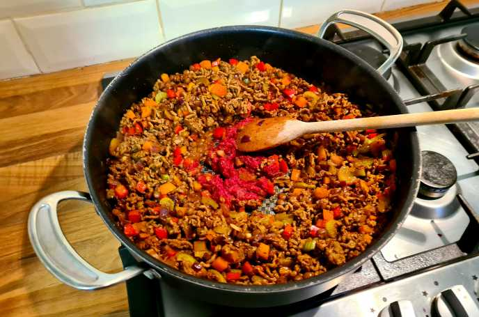 Making Chilli - Make a well for the tomato puree