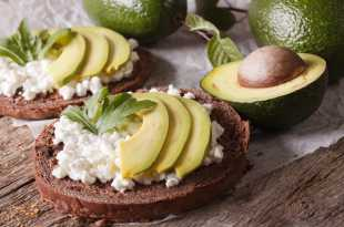 Rye Bread topped with cottage cheese and avocado