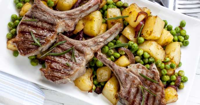 lamb chops on a bed of potatoes