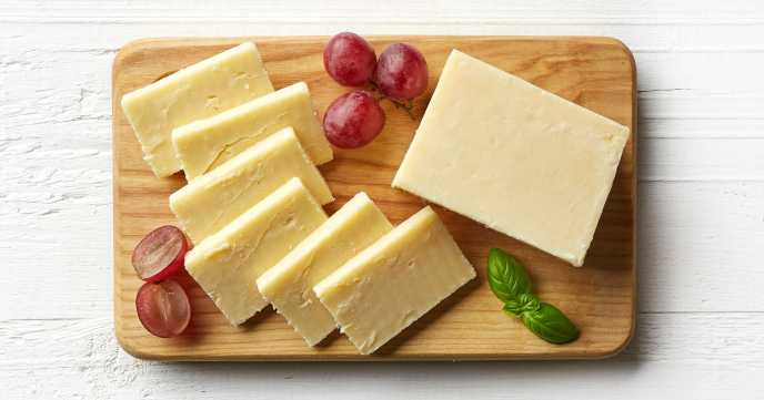 low calorie cheddar cheese on wooden board