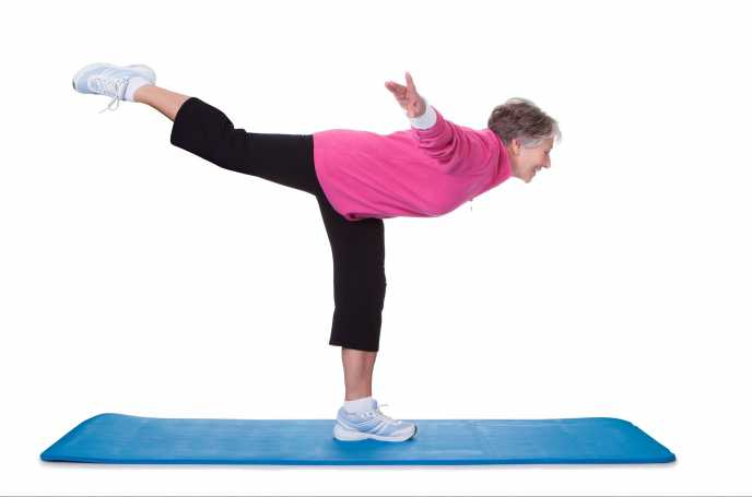 older woman in leg strength pose