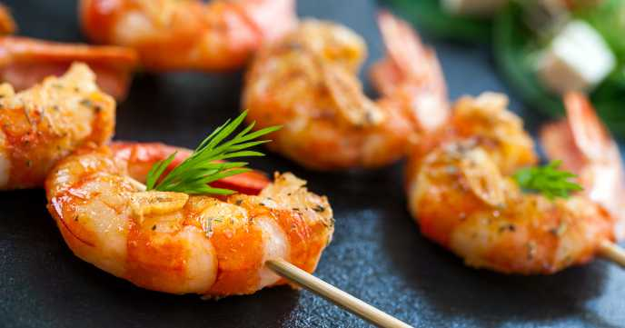 close up of prawns on a skewer