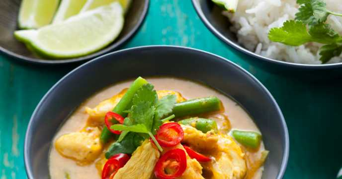 thai chicken curry in a bowl with rice