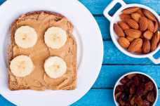 Toast with Almond Butter and Banana + Raisins - Weight Loss Resources
