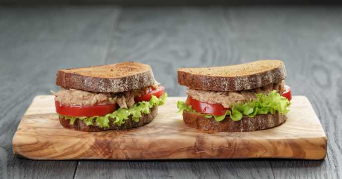 Tuna sandwiches on wooden boards